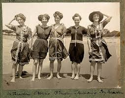 photo from 1908 of five women wearing very risque swim suits