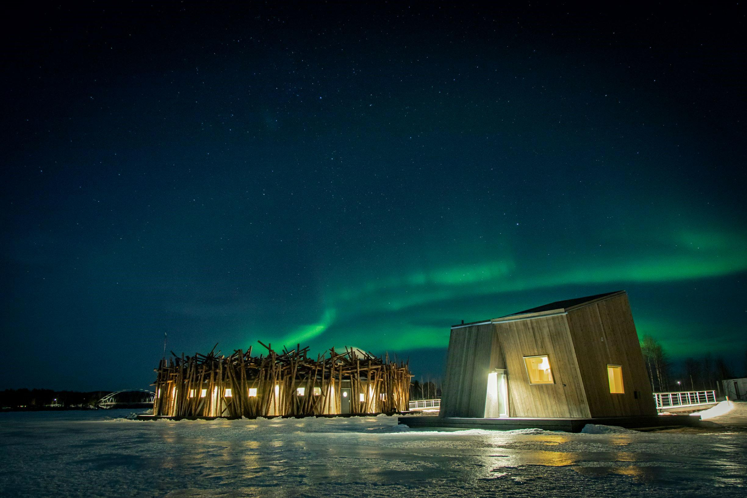 A Floating Hotel with Aurora Views Just Opened on a Frozen River in Sweden