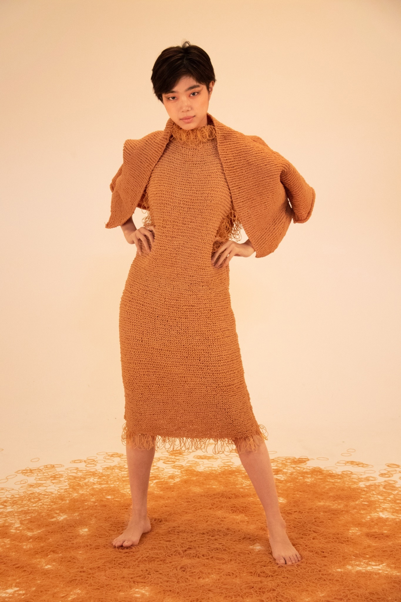 Fringed Orange Apparel Knit Entirely From Rubber Bands by Rie Sakamoto