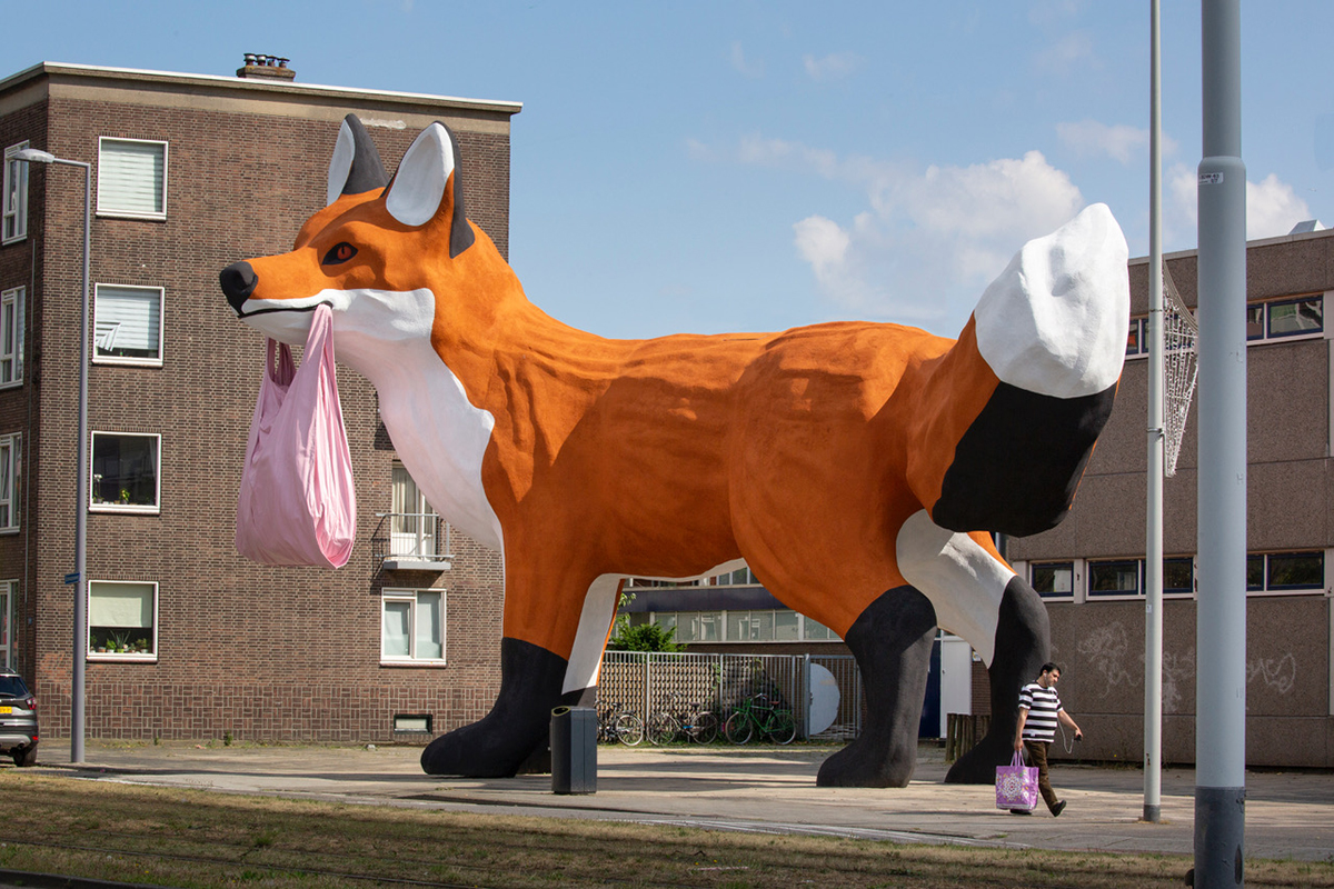 Gripping a Plastic Bag, A Massive Fox by Artist Florentijn Hofman Towers Over Rotterdam