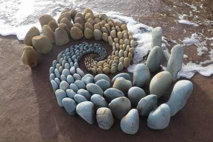 Precisely Arranged Stones Coil and Surge Across the Land in Jon Foreman's Mesmeric Works