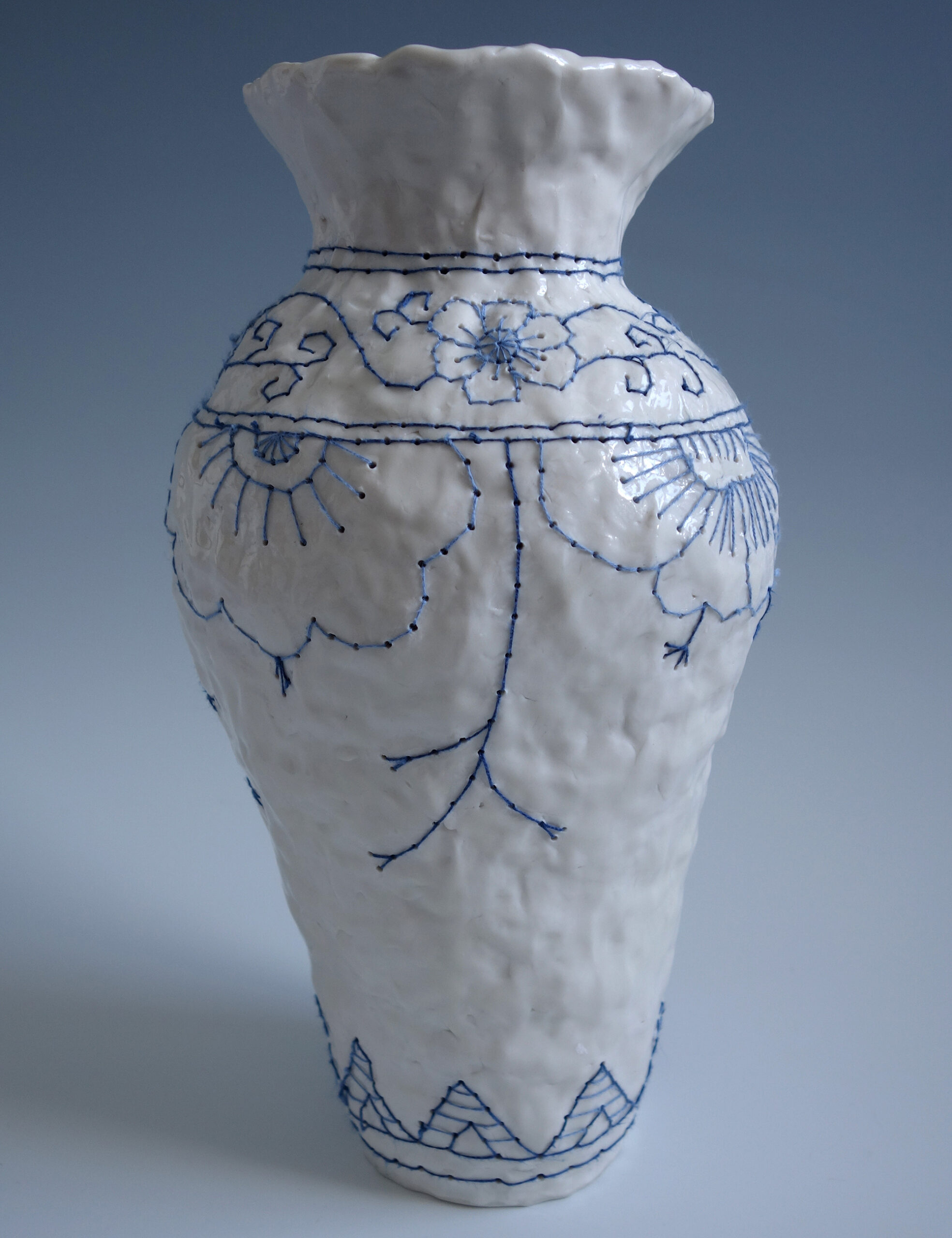 Readymade Cross-Stitch and Floral Motifs Are Embroidered Directly into Porcelain Vases