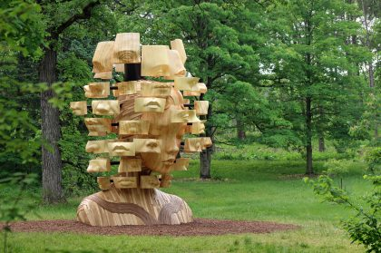 Five Towering Figures Sculpted in Wood by Artist Daniel Popper Loom Over The Morton Arboretum